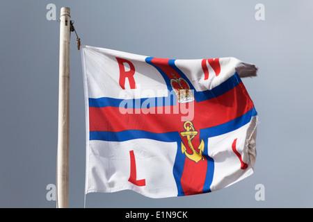 UK, Whitstable, Royal National Lifeboat Institute flag. - Stock Photo