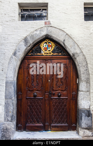 Double doorway in an arched entry of a building in Sion, Switzerland - Stock Photo