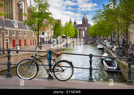 Bicycle on Amsterdam canal, Holland, Netherlands - Stock Photo