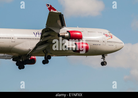 Side view of the front and wings of a Virgin Atlantic Airlines Boeing 747 on approach to land