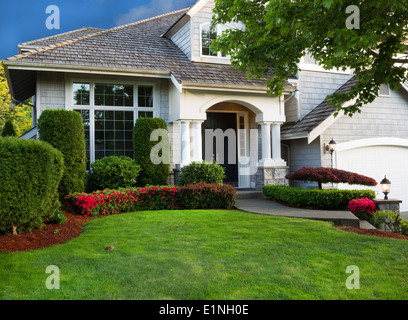 Detached house USA - large single family modern US house with landscaped gardens and lawn in spring - Stock Photo