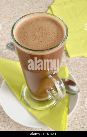 Hot chocolate in a tall latte glass - Stock Photo
