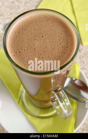 Hot chocolate in a tall latte glass top down view - Stock Photo