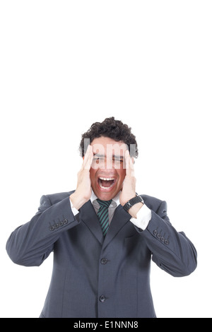 Portrait of stressed businessman screaming in pain and having headache, Business man under pressure with hands on - Stock Photo