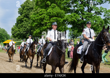 Ranger police riders show in city horse festival - Stock Photo
