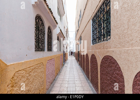 Traditional lime-washed narrow street inside the Medina in Rabat, Morocco. - Stock Photo
