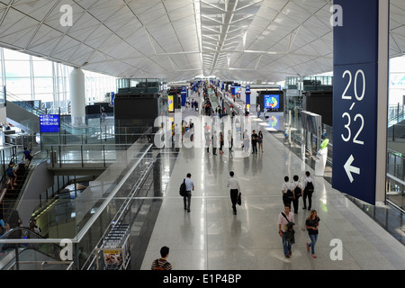 Departure area of Hong Kong International Airport located on the island of Chek Lap Kok. - Stock Photo