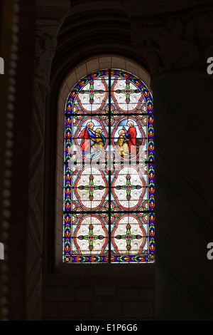 Stained glass window in Church Saint Pierre, Chauvigny, France. - Stock Photo