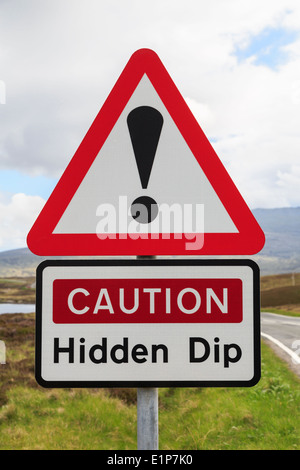 Triangular road sign warning Caution Hidden Dip with exclamation mark in red triangle. Outer Hebrides, Western Isles, - Stock Photo