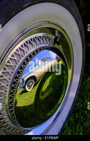 white wall tyre 1950s ford zephyr reflected in chrome wheel hub on display at bromley pageant of motoring annual