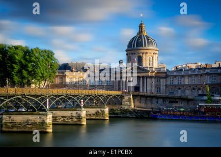 Evening view over Acadamie Francaise, Pont des Arts and River Seine, Paris France - Stock Photo