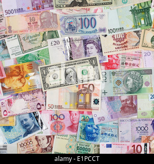 Banknotes from all over the world such as Euro, Dollar and Pound forming a background - Stock Photo