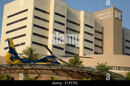 ANN ARBOR, MI - JUNE 3: Survival Flight helicopter sits at its helipad at the University of Michigan hospital on - Stock Photo