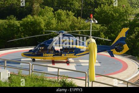 ANN ARBOR, MI - JUNE 3: One of the University of Michigan's Survival Flight helicopters sits at its helipad on June - Stock Photo