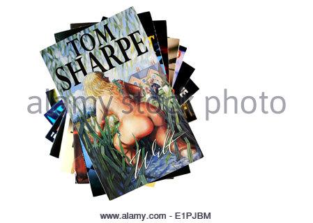 Tom Sharpe paperback novel Wilt, paperbacks stacked used books, England - Stock Photo