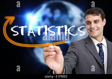 Businessman writing the word statistics - Stock Photo