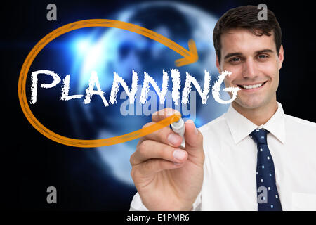 Businessman writing the word planning - Stock Photo