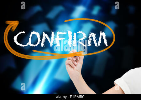 Businesswoman writing the word confirm - Stock Photo