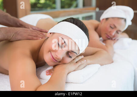 Pretty friends getting massages together - Stock Photo