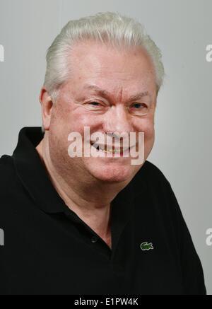 Berlin, Germany. 29th Jan, 2014. Dieter Schroth, partner of German fashion designer Harald Gloeoeckler, poses in Berlin, Germany, 29 January 2014. Photo: Jens Kalaene/dpa/Alamy Live News