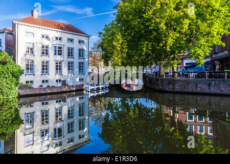 Canal and bridge in Bruges, Belgium from the Groene Rei or Green Bank - Stock Photo