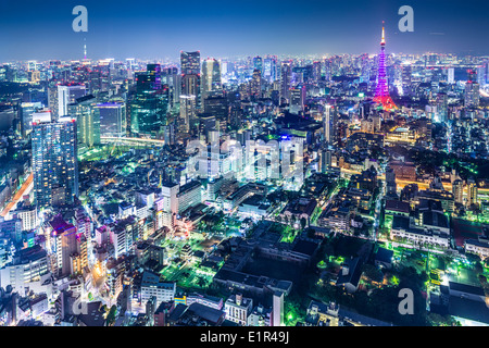 Tokyo, Japan city skyline with Tokyo Tower and Tokyo Skytree in the distance. - Stock Photo