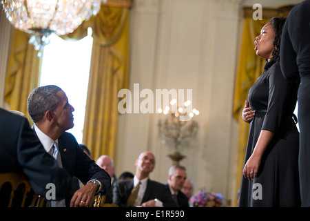 US President Barack Obama watches the Children of the Gospel Choir perform during the Easter Prayer Breakfast in - Stock Photo