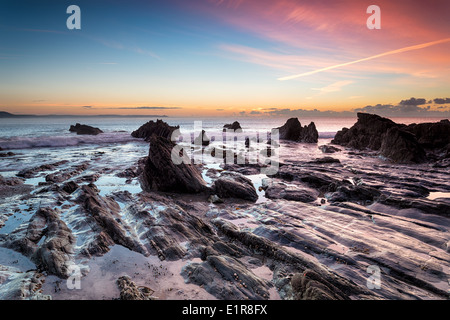 Sunrise on the south Cornish coast at Looe - Stock Photo