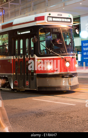 Streetcars in the city streets - Stock Photo