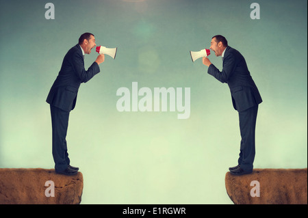 businessmen confrontation shouting at each other through loudhailers or megaphones business conflict concept - Stock Photo