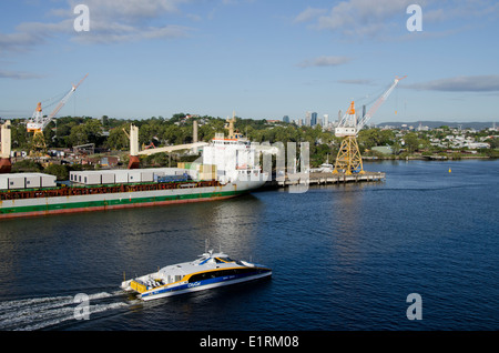 Australia, Queensland, Brisbane. City Cat high-speed city water taxi on the Brisbane River near port area. - Stock Photo