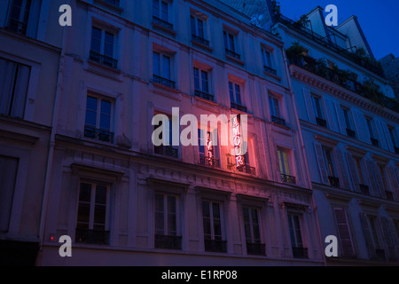 Neon sign outside the Amour Hotel at 8 rue Navarin, 9th Arrondissement, Paris, France. - Stock Photo