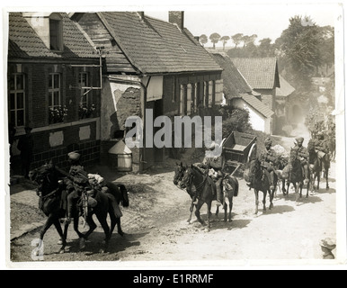 Indian cavalry marching through a French village [near Fenges]. . - Stock Photo