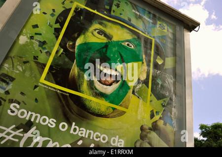Bankenwerbung mit Brasilien-Fan, WM 2014, Salvador da Bahia, Brasilien. Editorial use only. - Stock Photo