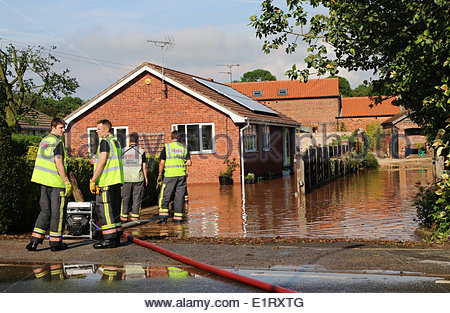 Clarborough, UK. 09th June, 2014. Fire and Rescue dealing with the effects of flash flooding after a vicious storm - Stock Photo