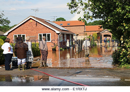 Clarborough, UK. 09th June, 2014. Dealing with the effects of flash flooding after a viscious storm  in Clarborough, - Stock Photo