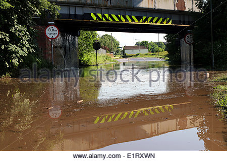 Welham, UK. 09th June, 2014. Flash flooding during a viscious storm on the A620 stopped all traffic at Welham on - Stock Photo