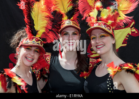 Three women dressed in samba costumes taking part in the West End festival and Mardi Gras, Glasgow, Scotland, UK - Stock Photo