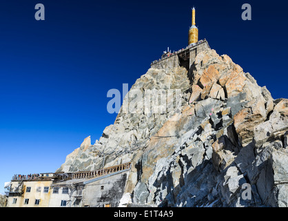 The Aiguille du Midi (3,842 m) is mountain in the Mont Blanc massif in the French Alps with panoramic view platform - Stock Photo