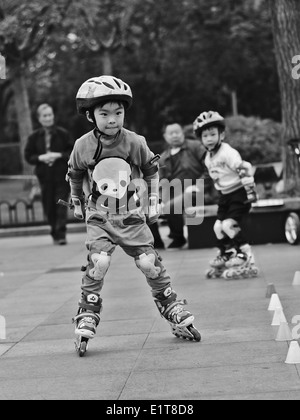 young asian child roller skating with full protective