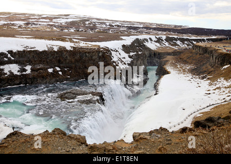 The river Hvita river flows through the Gullfoss gorge and over the Gullfoss waterfall in southwest Iceland. - Stock Photo