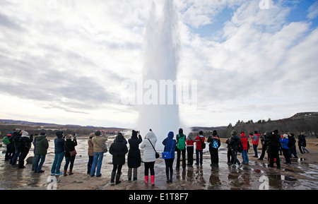 Strokkur geyser erupts at geothermally active valley of Haukadalur in Iceland. - Stock Photo