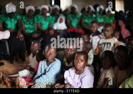 Villagers take part in a Christan Church service in the Murambi sector in the Rulindo district of Northern Province, - Stock Photo