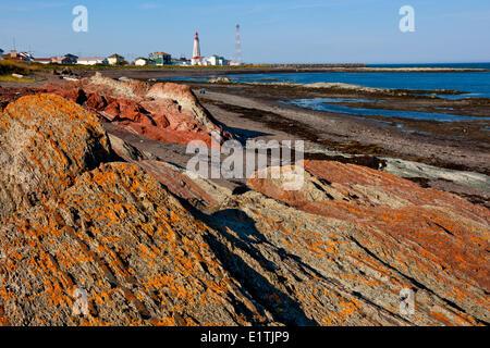 Coastline and lighthouse at Pointe-au-Père Maritime Historic Site,  Quebec, Canada - Stock Photo