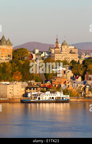 Car ferries docked in front of Old Quebec City at sunrise, Quebec City, Quebec, Canada - Stock Photo