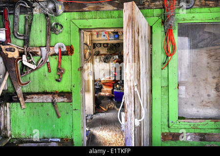 Tools hanging in a carver's shed, Resolute Bay, Nunavut, Canada - Stock Photo
