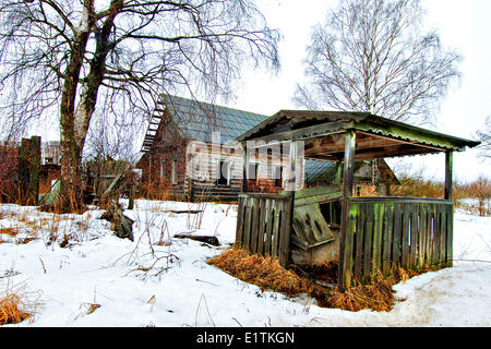 Derelict abandoned house in deserted Belarussian village in Chernobyl nuclear radiation zone Chernobyl, Belarus, - Stock Photo