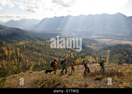 Young family hiking on Castle Mountain Trail in autumn, Fernie, BC, Canada. - Stock Photo