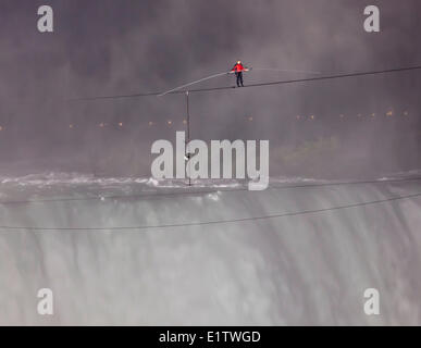 June 15 2012 Nik Wallenda Tightrope walking across Niagara Falls, Ontario, Canada - Stock Photo