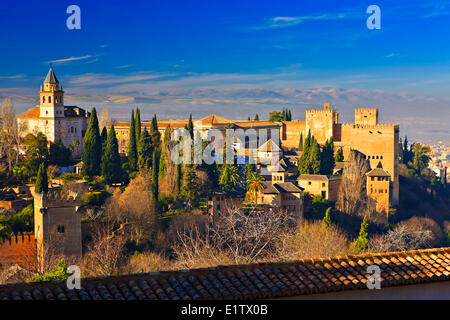View of The Alhambra (La Alhambra) from the Upper Gardens of the Generalife - designated a UNESCO World Heritage - Stock Photo
